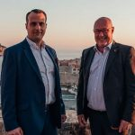 """COO Charles Grech and Chief Product Officer Wim Pardon accept Mastercard's Mover Shaker Award recognizing Truevo for its """"invaluable contribution to a cashless payment society."""""""