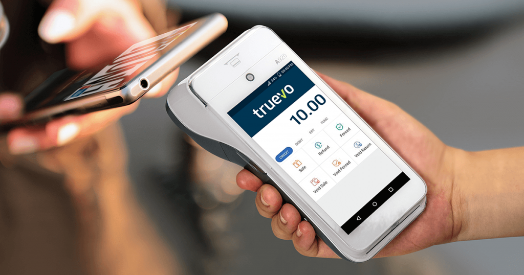 Truevo's smart terminal from PAX Technology takes a contactless mobile payment from a customer. The wireless device accepts Google Pay, Apple Pay, Visa, Mastercard and Maestro cards.
